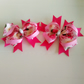 Beautiful pair of rose ribbon clips