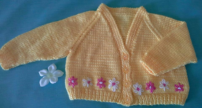 Lovingly Hand Knitted New born baby cardigan. Lovely sunny yellow with daisies