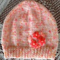 A sweet Beanie Hat in shades of peach for 6 to 12 month Baby Girl