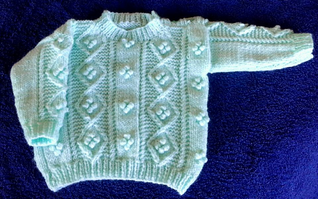 Unisex Aran style in Mint with button shoulder from Birth to 2 years.