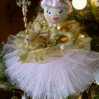 Sugar Plum Fairy in pink and gold. A beautiful fairy in Ballerina style.