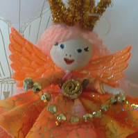 Stunning Peach & Gold Ballerina  Fairy. In a  tulle Tutu with iridescent wings.