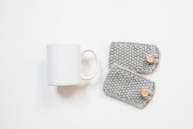 Pair of knitted mug cosies, cup cosy, coffee cosy in grey. Coffee mug cosy