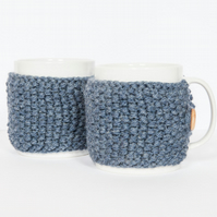 Pair of knitted mug cosies, cup cosy, coffee cosy in Denim Blue. Coffee mug cosy