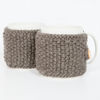 Pair of knitted mug cosies, cup cosy, coffee cosy in Charcoal. Coffee mug cosy
