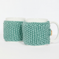 Pair of knitted mug cosies, cup cosy, coffee cosy in Teal. Coffee mug cosy