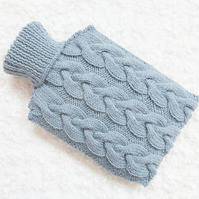Hand knitted hot water bottle cover, cosy in blue. Rustic bedroom, home decor