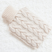 Hand knitted hot water bottle cover, cosy in cream. Rustic bedroom, home decor