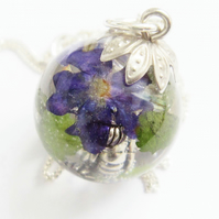Bespoke clear resin and real flower sphere pendant necklace. 20mm x 20mm
