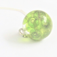 Bespoke clear resin and green glass beads pendant necklace. 16mm x 16mm