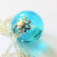 Bespoke clear resin and turquoise glass bead pendant necklace.