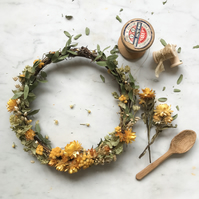 A Beautiful Dried Flower Wreath Featuring yellow and green tones