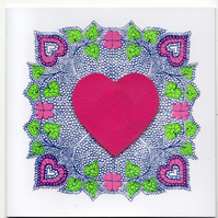 Hand printed valentines card with hearts and flowers blank inside