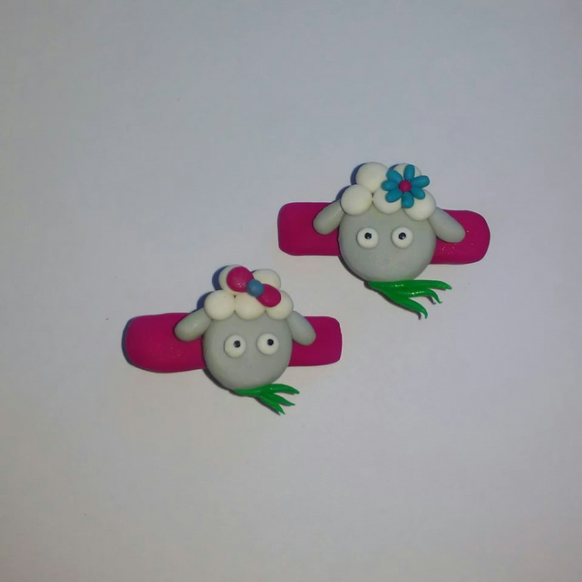 Sheep grazing on grass hair clips
