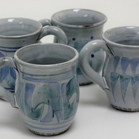 Ceramic coffee mugs thrown on the potters' wheel by finola delamere