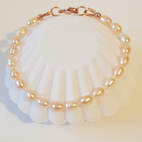 Peach Pearl Knotted Bracelet