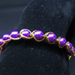 Amethyst Glass Pearl Bracelet wrapped in Gold Plated Wire.