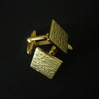 Gold plated retro design, textured surface, square cufflink, rhodium base.