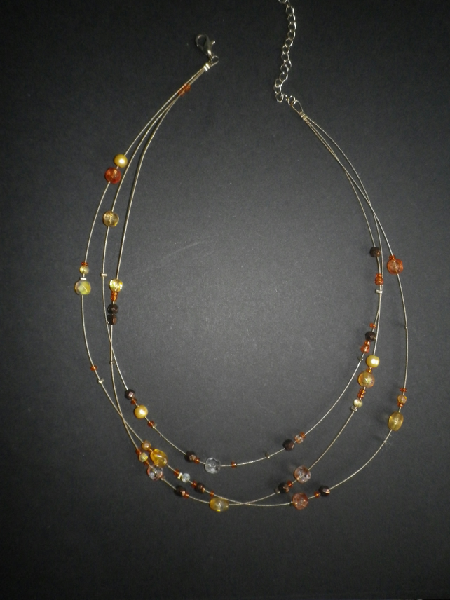 Elegant lightweight triple strand amber and gold informal necklace