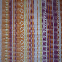 Gold and brown decorative stripe on cotton , dramatic design, price per metre