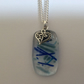 Blue water fused glass pendant with heart charm detail