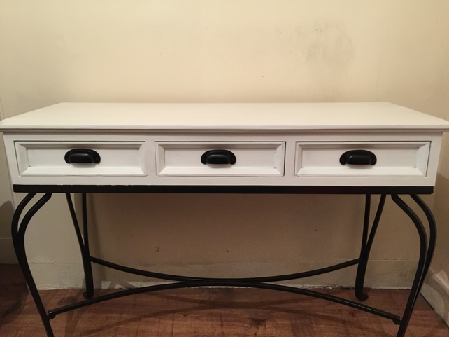 Three drawer wooden console table with 3 drawers on ornate metal legs