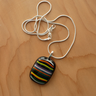 Bright stripes on black glass necklace