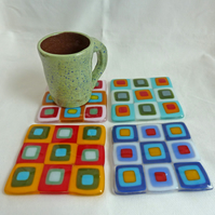 Set of 4 glass coasters with a retro colourful square pattern