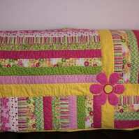 Bright beautiful baby girl quilt