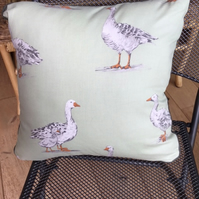 Goose print cushion in sage green.