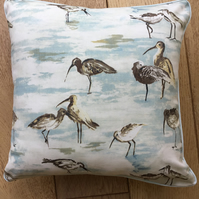 Square cushion with wading birds design