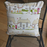 Thatched cottage cushion with village street scene
