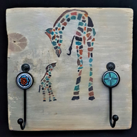 Giraffe themed wall hooks on recycled wooden scaffold board