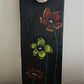 Floral on black coat hook on recycled wooden scaffold board