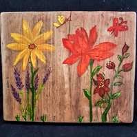 Floral art on reycled wooden scaffold board