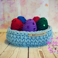 Easter eggs in crochet basket.