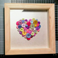Multicoloured button heart frame