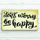 Don't worry be happy sign.