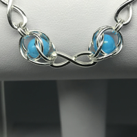 Sterling Silver Captured Turquoise Infinity Symbol Necklace