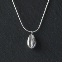 Silver cowrie shell necklace