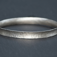 Thin hammered anticlastic bangle