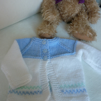 Blue and white baby cardigan, from Birth