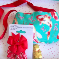 Girls bag with fish design, ribbon strap and accessories included