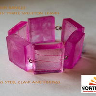 Pink resin skeleton leaf bangle made with cubes.