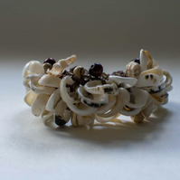 Brown hemp crochet bangle with shells and lots of beads