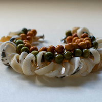 Green hemp crochet bangle with wooden beads and shells