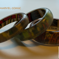 Three chunky Marvel comic resin bangles