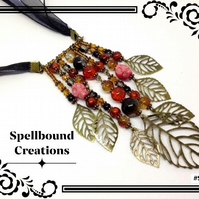 Steampunk Bronze Tone Leaf And Skull Bead Dangle Black Ribbon Necklace. SP1