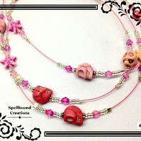 Three Strand Skull And Star Beaded Pink Wire Necklace. B7