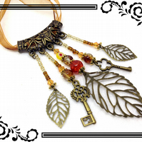 Steampunk Leaf & Key Bronze Tone Beaded Dangle Ribbon Necklace. 94